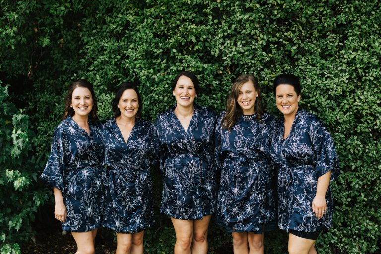 Bride and bridesmaids in wedding dressing gowns at Beaumont House