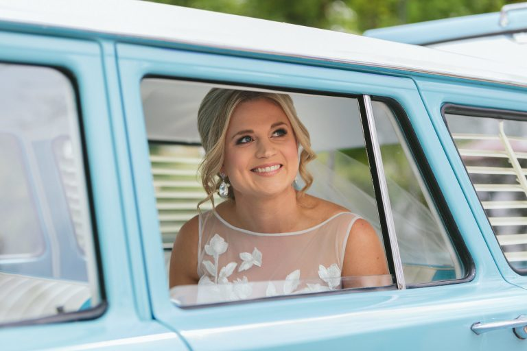Blonde bride in car at Hahndorf in Adelaide